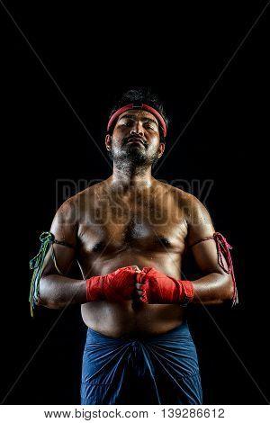 Muai Thai Boxer Man Trainings. Studio Shot On Black Background
