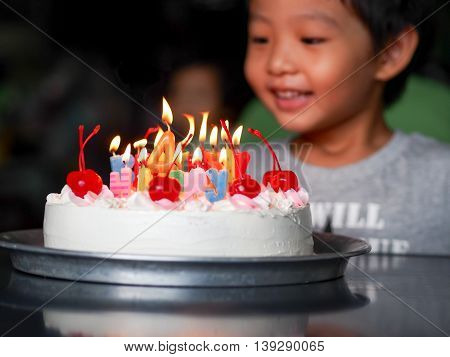 Adorable four year old kid boy celebrating his birthday