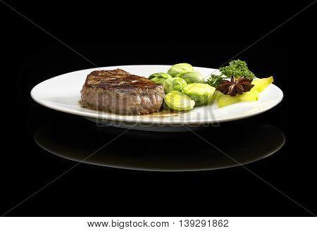 close up image of filet mignon on black background