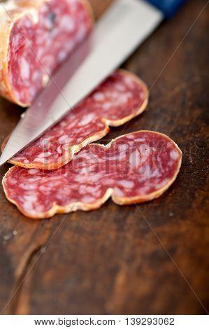 close up image of italian salame pressato pressed slicing