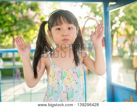 Asian Baby Child Playing On Playground, In Sunset Light, Peekaboo Action