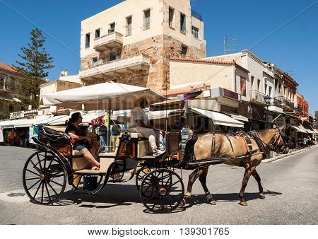 CHANIA, GREECE - JULY 9, 2016: Horse carriage in Chania old town. Crete Greece