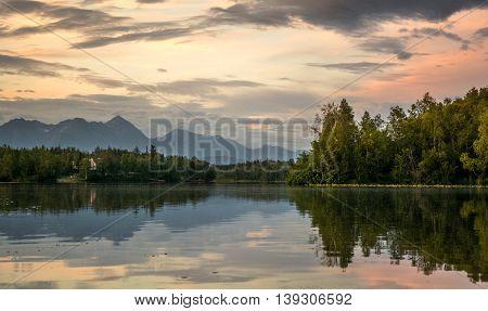 Enjoying the sunset, while kayaking on the Cottonwood Lake, in Wasilla, AK