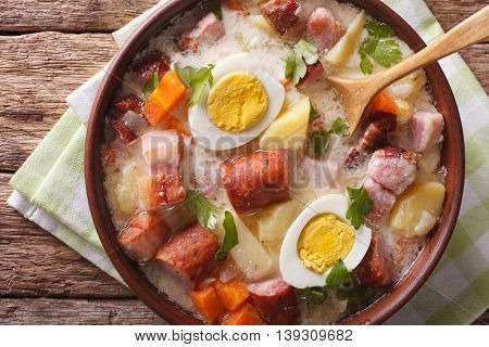 Delicious Polish Soup Zurek With Sausage And Eggs In A Bowl. Horizontal Top View