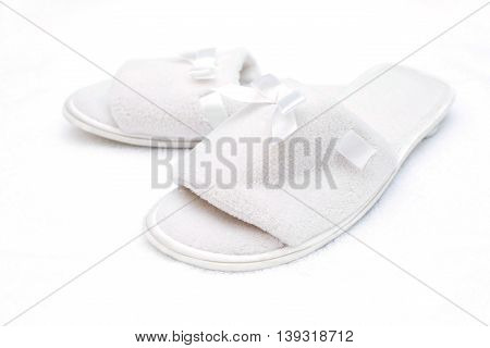 White house Slippers on a white towel. poster