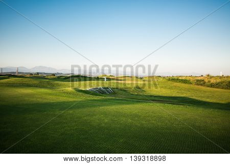Golf Course With Sand Trap At Sunset