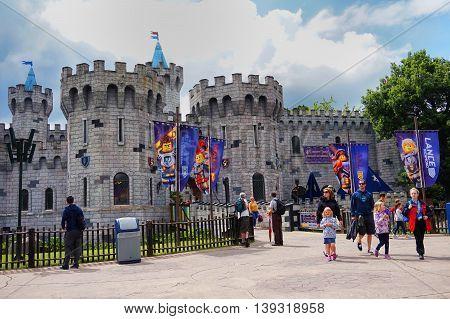 Legoland, Windsor, Uk - April 30, 2016: Visitors Outside The Nexo Knights Castle At Legoland