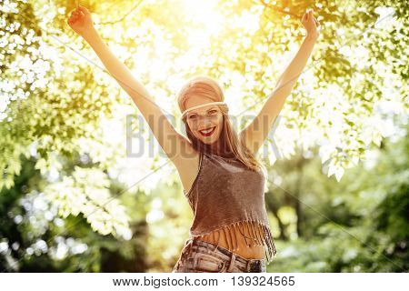Beautiful young happy blonde hippie in nature