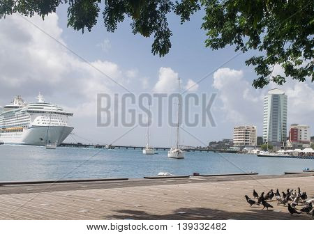 FORT DE FRANCE, MARTINIQUE -NOVEMBER 25, 2015 : Landscape of Fort-de-France. Martinique harbor, cruise ship, sailboats, and urban district.