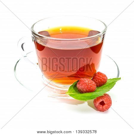 Transparent cup of black tea raspberry and mint leaf on white background