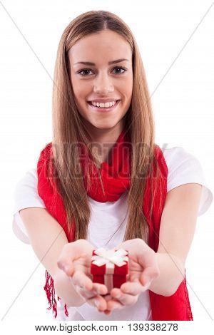 Smiling beautiful girl holding gift, isolated on white
