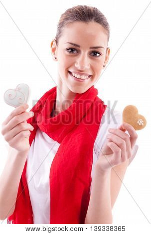 Smiling beautiful girl holding candy hearts, isolated on white