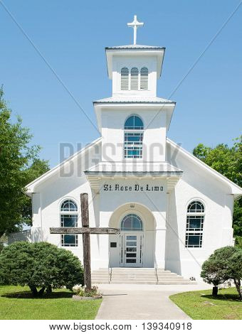 BAY ST. LOUIS, MISSISSIPPI - MAY 2015 : Historic St. Rose De Lima Church in Bay St. Louis, Mississippi, was constructed in the early 1920's. Altar has a large mural