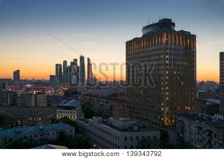 Golden ring hotel and skyscrapers in evening during sunset in Moscow, Russia