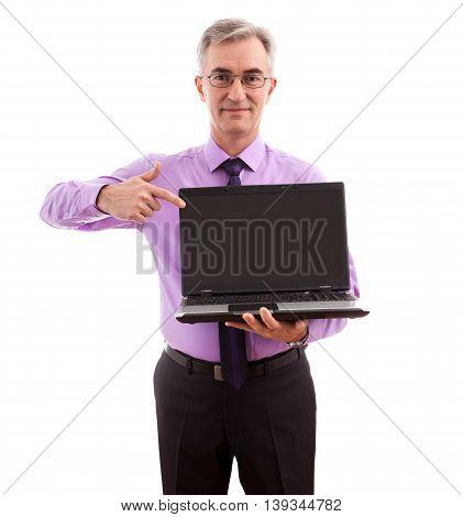 Senior businessman holding lap top, close up