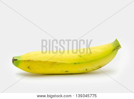 one cavendish Banana  have not peel Isolated