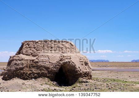 Hut in the bolivian desert with but sky
