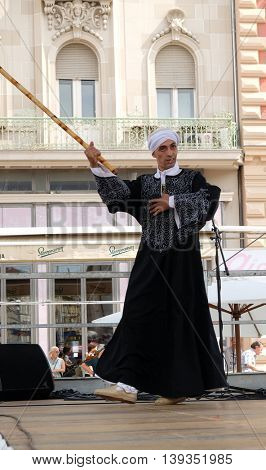 Members of Al Tannoura Folklore Troupe, Cairo, Egypt during the 50th International Folklore Festival in center of Zagreb, Croatia on July 20, 2016