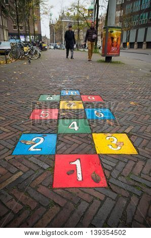 AMSTERDAM NETHERLANDS - NOVEMBER 15 2015: Colorful hopscotch game in the streets of amsterdam