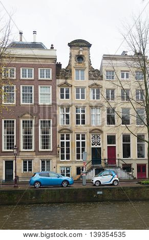 AMSTERDAM - NOVEMBER 15 2015: Electric cars being loaded. Car2go has 300 electric cars for rent in the city. Also they offer free parking in special car parks and at the loading points