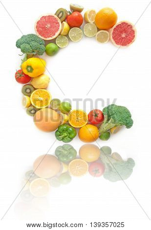 C shape letter made from fruits and vegetables high in vitamin C