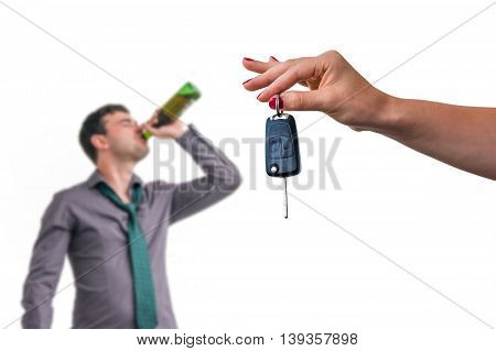Wife Showing Car Keys And Her Husband Drinking Alcohol