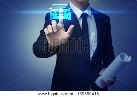 Close up of businessman touching car icon on virtual screen