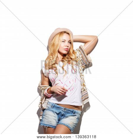 Fashion Model Girl Portrait Dressed In Top, Cardigan, Denim Shorts, Hat And Modern Accessories
