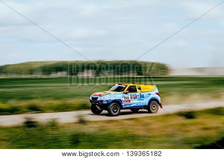 Filimonovo Russia - July 11 2016: rally car rides at high speed on a dusty road during Silk way rally