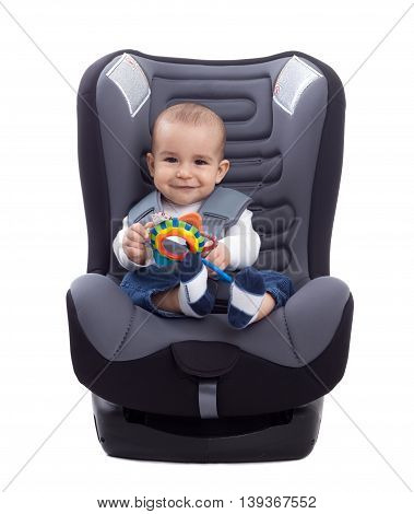 Adorable Little Kid Sitting In A Car Seat
