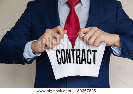 Businessman Tearing Contract Apart On White Background