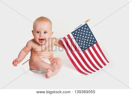 Adorable Baby Girl Holding An American Flag On White Background