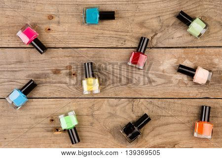 Bottles Of Colorful Nail Polish On Brown Wooden Table