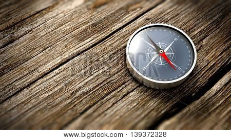 Compass showing the north on a wooden table. Close up view. Objective concept. 3D Rendering