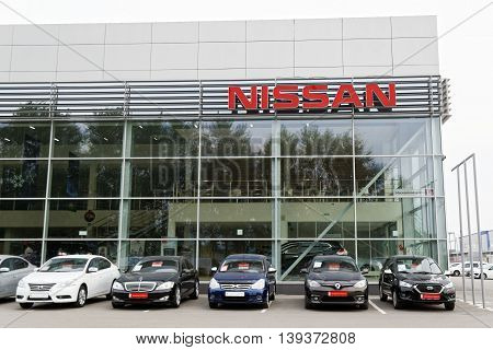 Building Of Nissan Car Selling And Service Center With Nissan Sign.