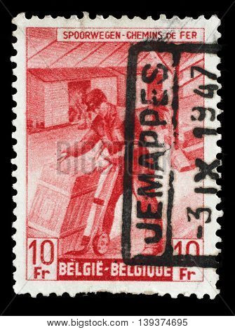 ZAGREB, CROATIA - JULY 03: A stamp printed in Belgium shows Box-shipper from The Railway Company at Work issue, circa 1945, on July 03, 2014, Zagreb, Croatia