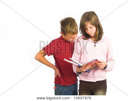 Young girl and boy standing with books , isolated on white