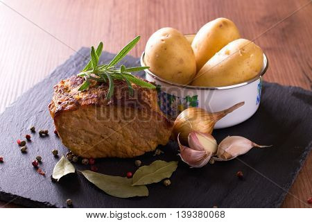 Baked Pork Meat With Vegetable On Slate Stone