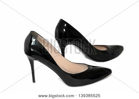 Beautiful elegant shoes for women black patent leather high heels. Presented on a white background.