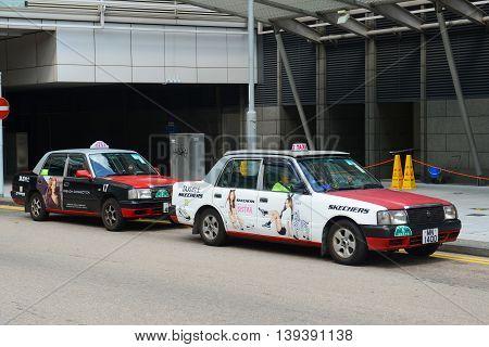 HONG KONG - NOV 9: Hong Kong Urban red Toyota Crown Confort YXS10 four seats taxi on Nov 9, 2015 in Hong Kong Island.