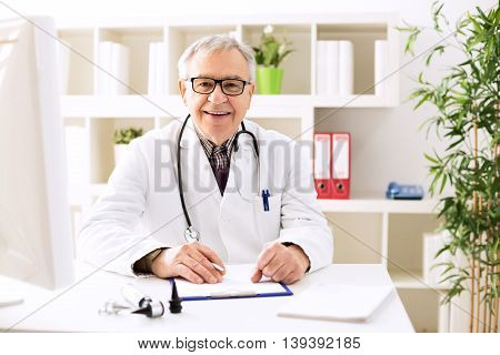 Specialist otologist doctor smiling and posing in office