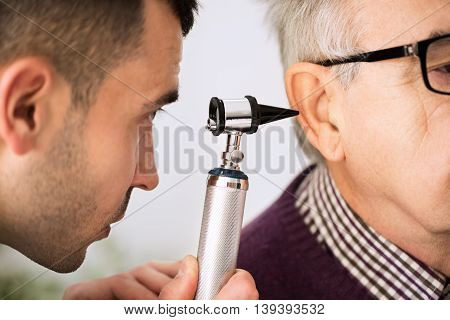 Doctor Examining Ear Of A Patient