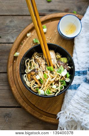 One bowl of chicken chow mein with shiitake