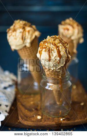 Dulce de leche ice-cream cone with dripping caramel sauce