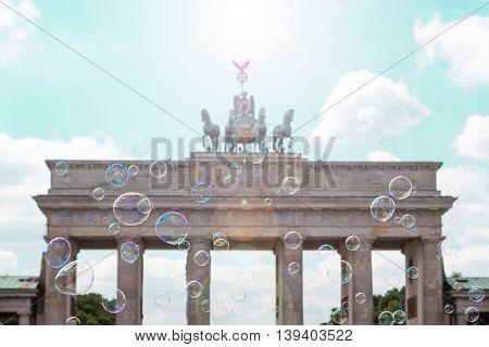 berlin symbol brandenburg gate (Brandenburger Tor) behind soap bubbles