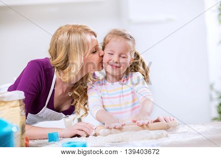 Lovely Mother Kissing Worth Daughter