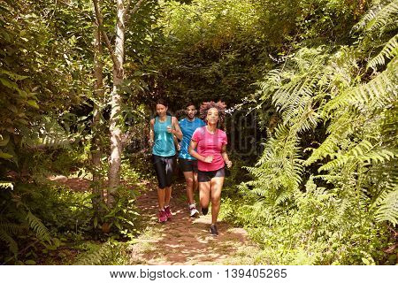 A Boy And Two Girls Running