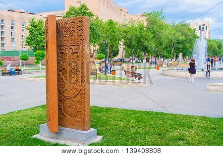 YEREVAN ARMENIA - MAY 29 2016: The book-khachkar on the open air exhibition named The Cultural Genocide: symbol of Khachkars on May 29 in Yerevan.