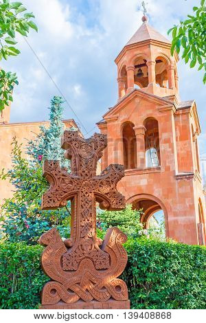 YEREVAN ARMENIA - MAY 29 2016: The red tuff Khachkar is the masterpiece of Armenian art located on territory of St John the Baptist Church on May 29 in Yerevan.