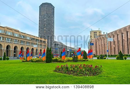 YEREVAN ARMENIA - MAY 29 2016: The view on the black tower of Yerevan Ararat Wine Factory from the Square of Russia on May 29 in Yerevan.